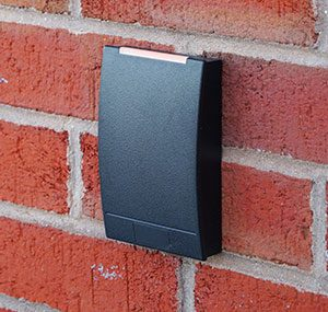 access control in london & essex areas picture of key card reader on brick wall.