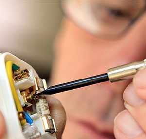 domestic electrician in london & essex area photo of man fixing plug